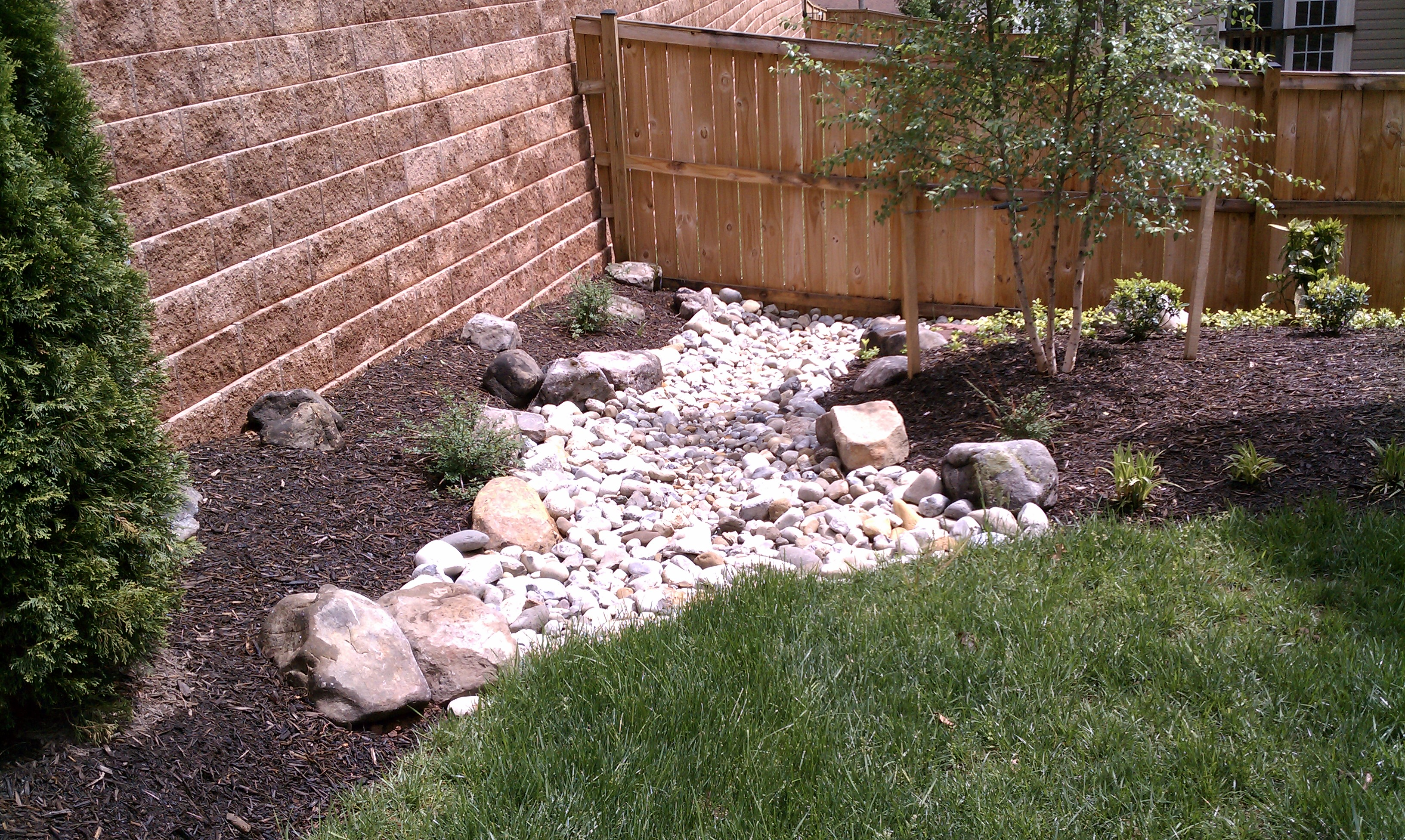 Dry streambeds for drainage in the landscape for Landscape drainage design